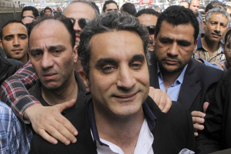 A bodyguard protects popular Egyptian television satirist Bassem Youssef, who has come to be known as Egypt's Jon Stewart.