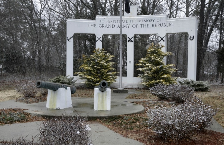 In this Thursday, March 21, 2013 photograph, a monument and canons are seen at a small veteran's memorial park in a neighborhood in Manchester Township, N.J. On the center column is a small plaque to the USS Akron airship that went down in a violent storm off the New Jersey coast. The disaster claimed 73 lives, more than twice as many as the crash of the Hindenburg four years later. The USS Akron, a 785-foot dirigible, was in its third year of flight when a violent storm sent it crashing tail-first into the Atlantic Ocean shortly after midnight on April 4, 1933.