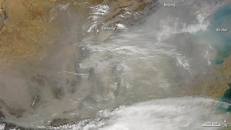 NASA's Aqua satellite captured this image of a dust storm from the Gobi Desert that blew across the coastal plain of eastern China in mid-March 2013. This week, California air pollution watchdogs report dust from that storm reached Owens Valley, on the east side of the Sierra Nevada.