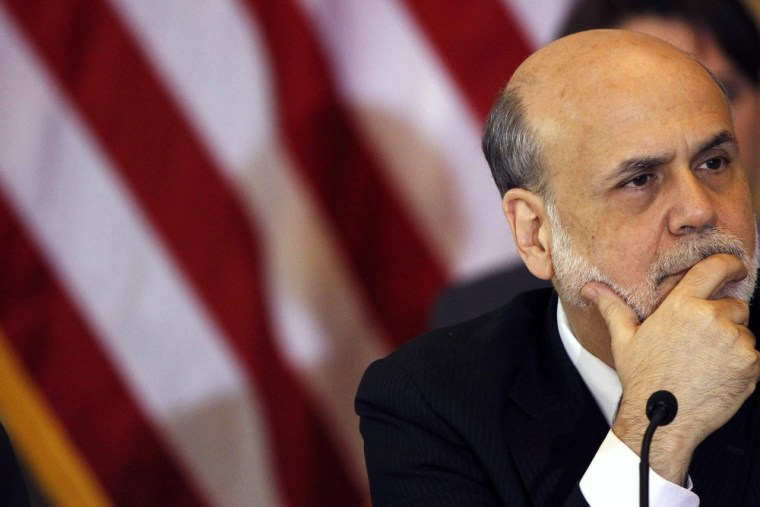 In this file photo, Chairman of the Federal Reserve Bank Ben Bernanke attends the Treasury Department's Financial Stability Oversight Council in Washi...