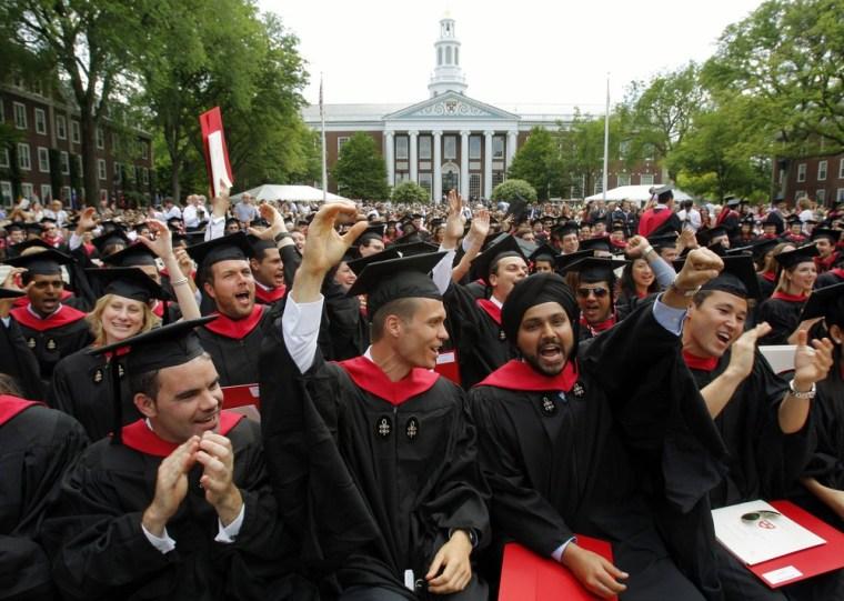 Harvard Business School students cheer during their graduation ceremonies in Boston, Mass., in June 2009.