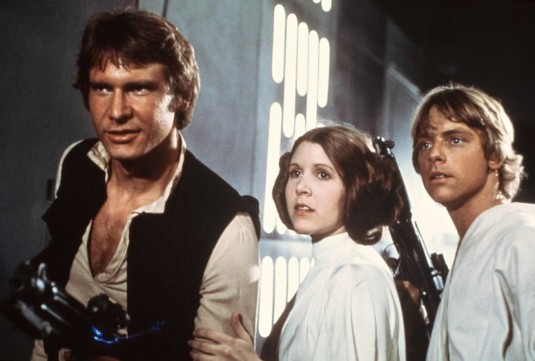 FILE - This file publicity image provided by 20th Century-Fox Film Corporation shows Harrison Ford, as Han Solo, Carrie Fisher, as Princess Leia Organ...