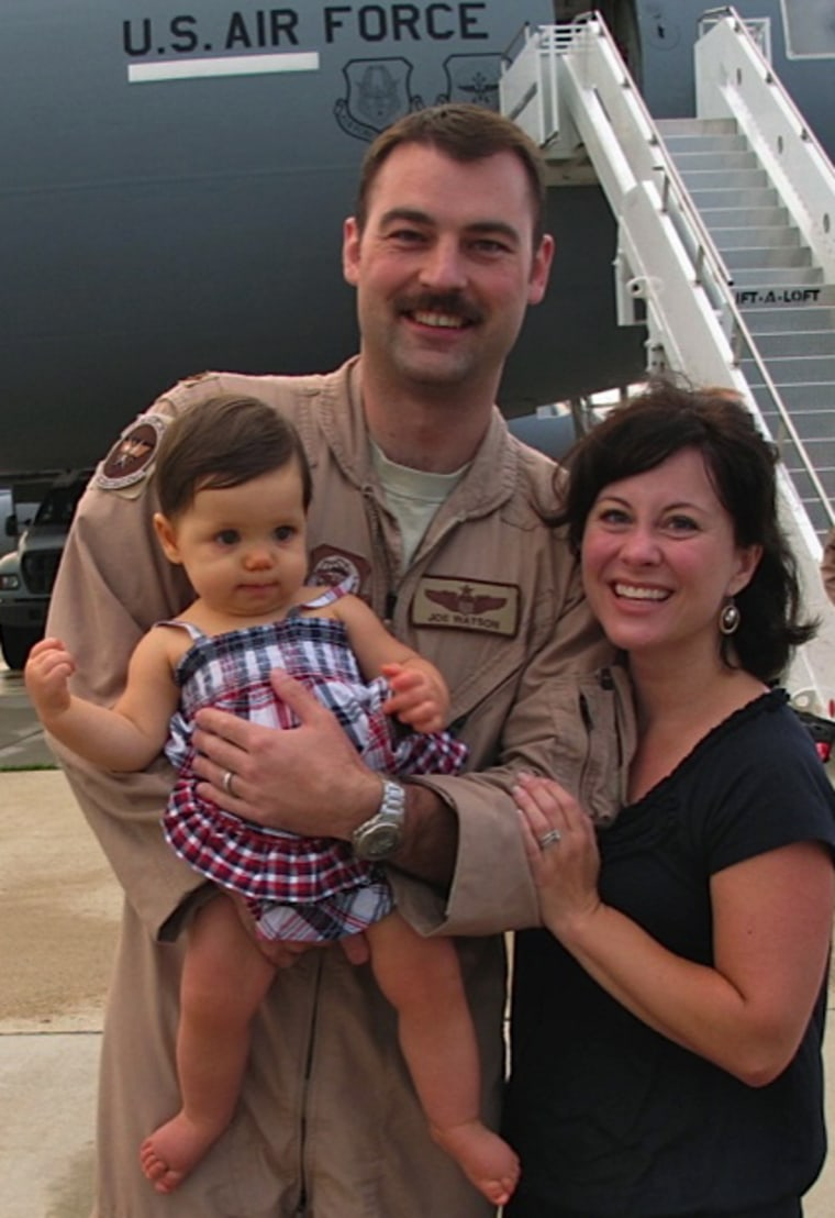 Marit Watson with her husband and daughter, after he arrived home from his deployment in the summer of 2012.