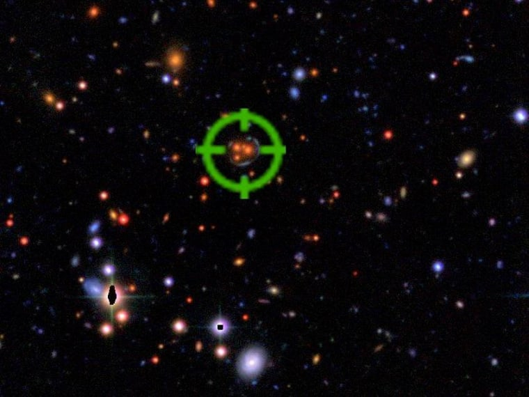 The green crosshairs pinpoint a gravitational lens lurking in an astronomical image.