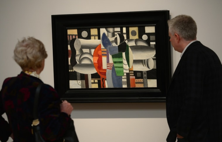 ""\""""Trois Femmes a la Table Rouge"""" by Fernand Leger, on display during a preview of the Sotheby's auction Tuesday.""760|485|?|en|2|c5276a1a075a18d0e590eb15017001a9|False|UNLIKELY|0.35762330889701843