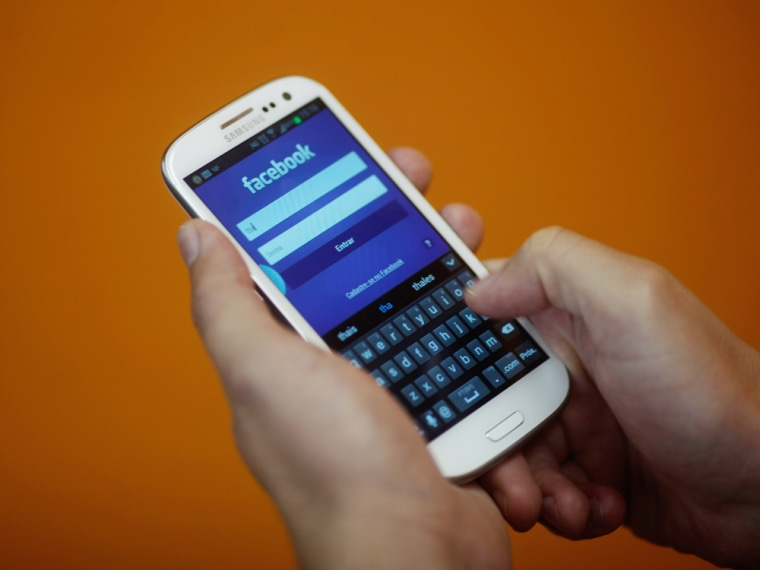 A smartphone user logs into his Facebook account in Rio de Janeiro April 15, 2013. As Brazil rushes to introduce a blazing-fast fourth-generation wire...