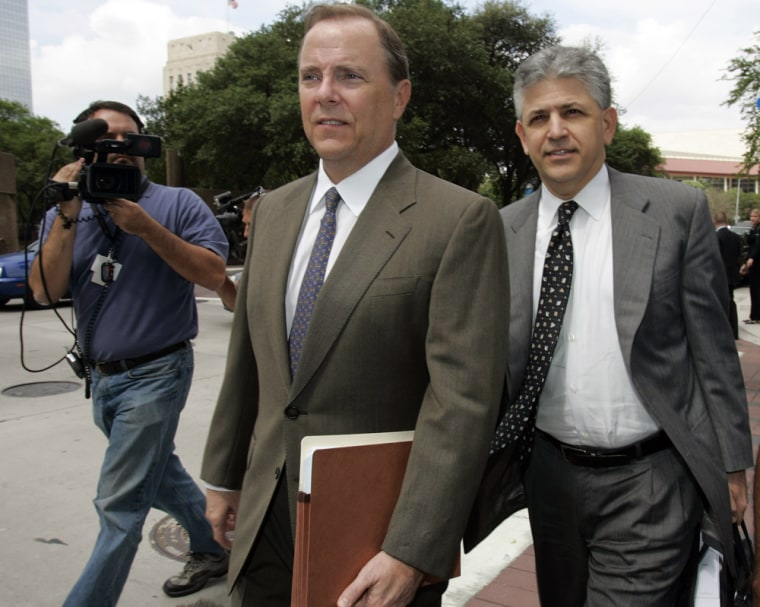Former Enron executive Jeffrey Skilling, left, and his attorney Daniel Petrocelli leave the federal courthouse for lunch in week ten of his fraud and ...