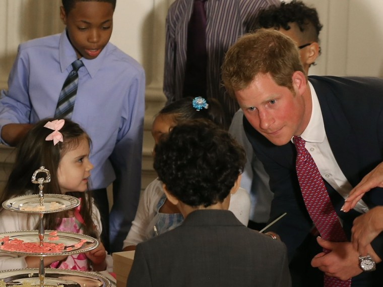 WASHINGTON, DC - MAY 09:  Prince Harry talks to young children during an event hosted by first Lady Michelle Obama to honor military families at the W...