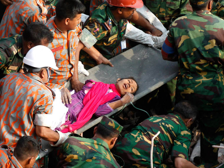 Rescuers pull out a female survivor, Reshma, alive on the 17th day after the Rana Plaza building collapsed, in Savar, Dhaka, Bangladesh, 10 May 2013. Television footage showed troops removing the survivor, identified as Reshma Begum, from the rubble and taking her to an ambulance.