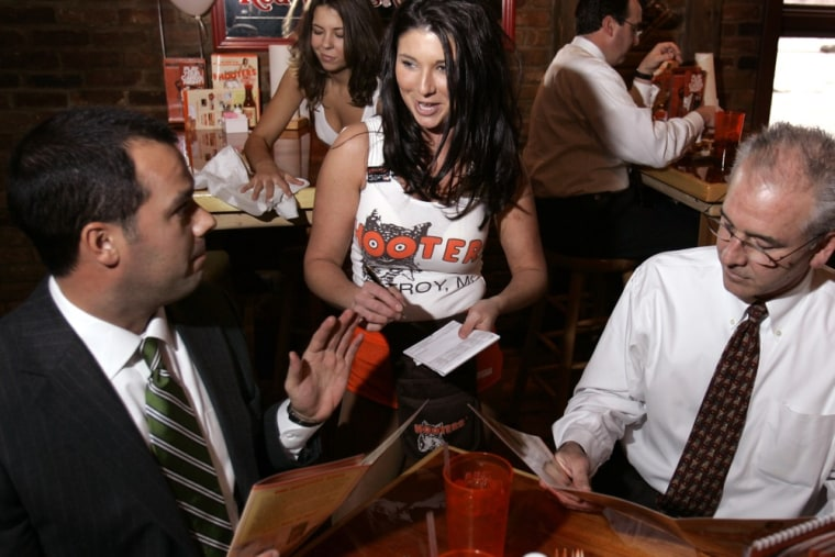 No mom, no free meal. Hooters waitress takes lunch orders from diners at a restaurant in Troy, Mich., Tuesday, Jan. 30, 2007.