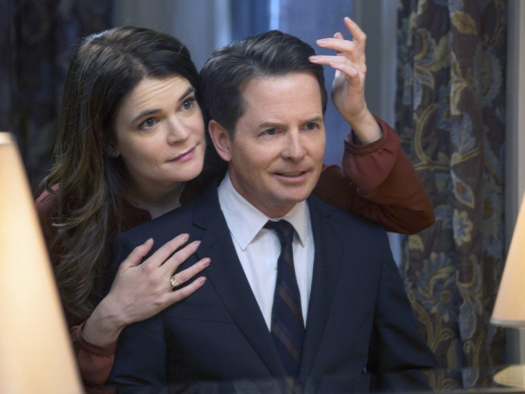 THE MICHAEL J. FOX SHOW  -- Pilot -- Pictured: (l-r)  Betsy Brandt as Annie Henry, Michael J. Fox as Mike Henry -- (Photo by: Eric Liebowitz/NBC)