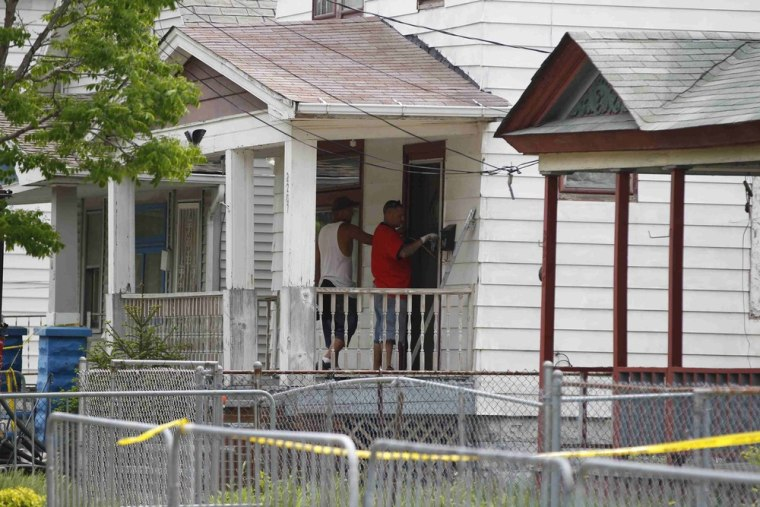 Workers unload materials at Ariel Castro's home in Cleveland, Ohio, May 10, 2013. Castro is accused of kidnapping and raping three women during a deca...