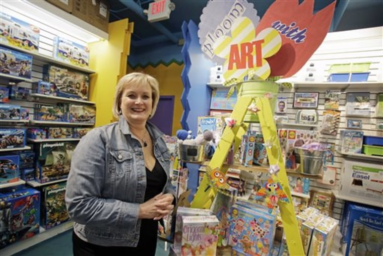 In this photo taken Tuesday, May 14, 2013, Roberta Bonoff, owner of Creative Kidstuff, a toy store chain, poses at the store in St. Paul, Minn. The t...