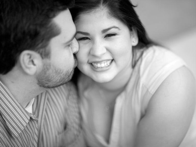 Image: Rachael Clark gets a kiss from her fiance Matt