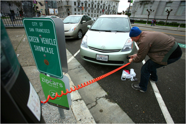 Andrew Utter plugging his converted Toyota Prius into a charging station across the street from City Hall in San Francisco.