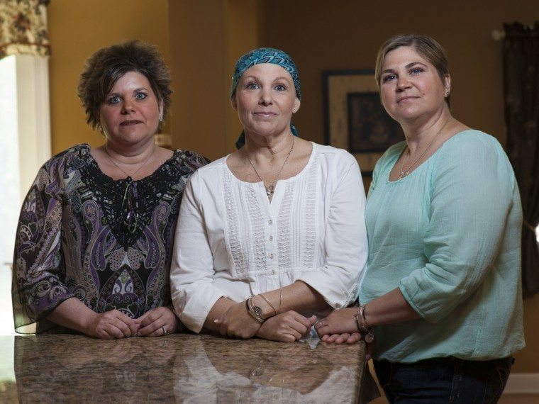 Sisters Cathy Balsamo, left, Patti Broccoli, center, and Cindy Lepore, right, have all tested positive for the BRCA1 genetic mutation that raises the risk of breast and ovarian cancer. All three sisters have had preventive surgery to have their breasts and ovaries removed. Two weeks after her surgery, Broccoli was diagnosed with breast cancer.