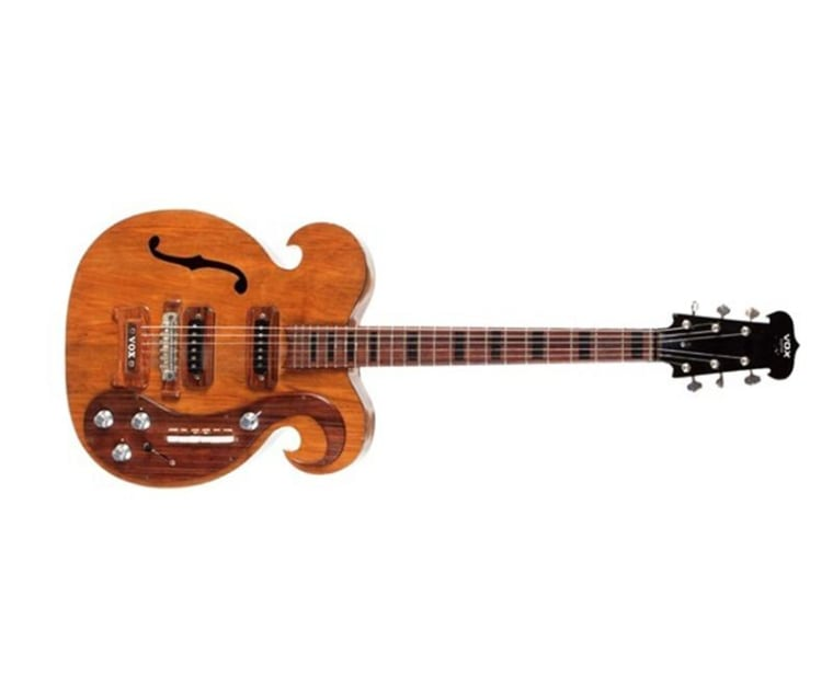 This custom-made electric guitar played by the late John Lennon and George Harrison of the Beatles recently sold at auction.