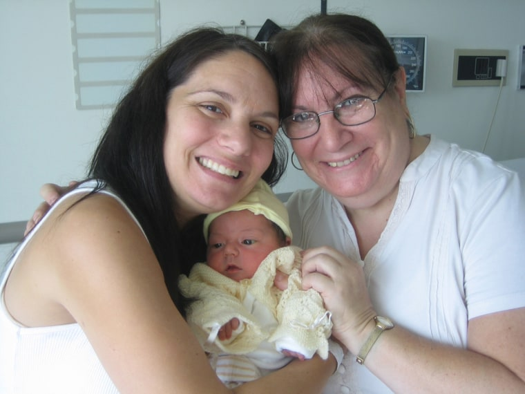 Wendy Bradford, her mom Marsha Freeman, and daughter Molly in the hospital just after Molly's birth.