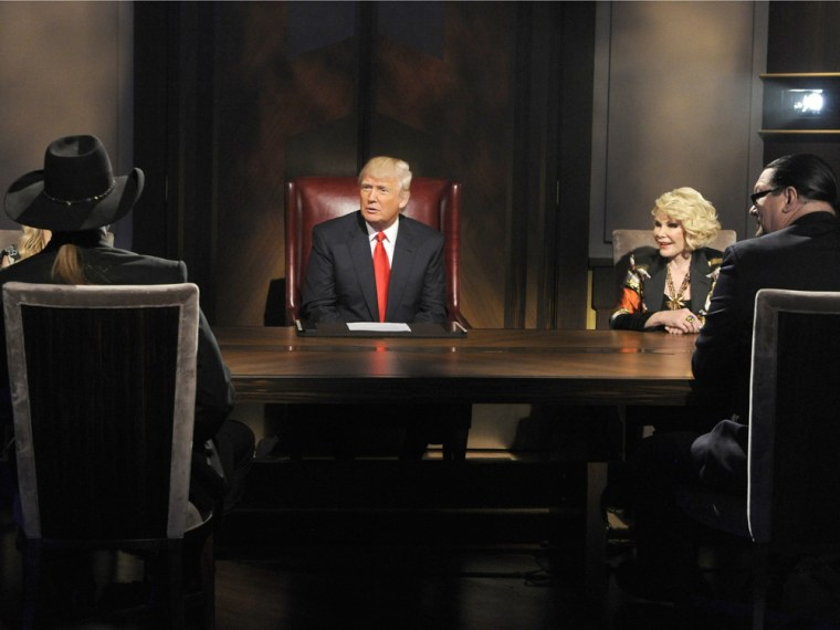 """Donald Trump sizes up the \""""All-Star Celebrity Apprentice\"""" finalists while boardroom advisor Joan Rivers looks on."""
