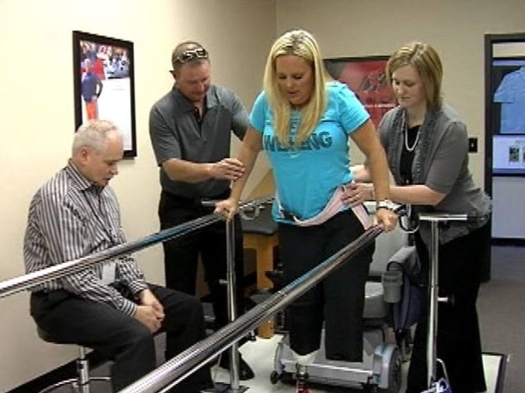 Stephanie Decker, shown when she first learned to walk using prosthetic legs.