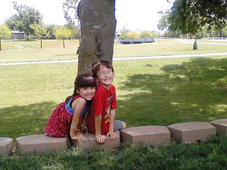Spencer and Lauren Farthing in Veterans Memorial Park in Moore, Okla. The photo was taken a few years ago. The park was destroyed by Monday's tornad...