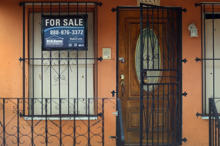 A for sale sign is seen in front of a home on April 29, 2013 in Miami, Florida.