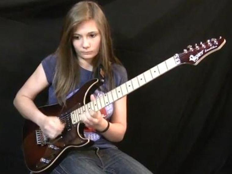 Image: Tina S. playing guitar solo