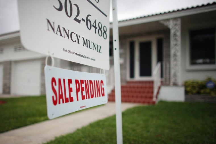 A Sale Pending sign is seen in front of a home on April 29, 2013 in Miami, Florida.
