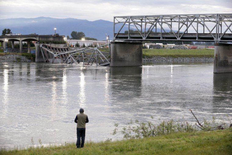 A person looks from the south bank of the Skagit River across to the collapsed portion of the Interstate 5 bridge Friday, May 24, 2013, in Mount Verno...