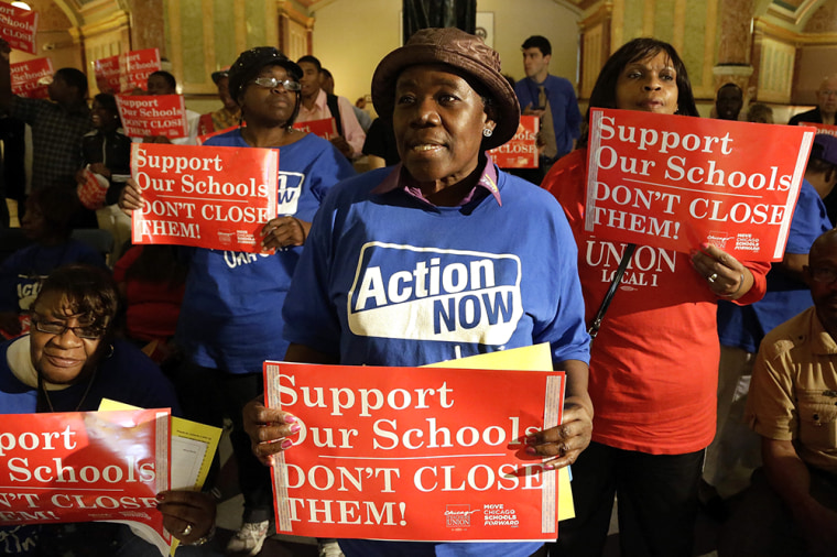 Protesters of Mayor Rahm Emmanuel's plan to close dozens of city schools rally in the rotunda at the Illinois State Capitol last week.