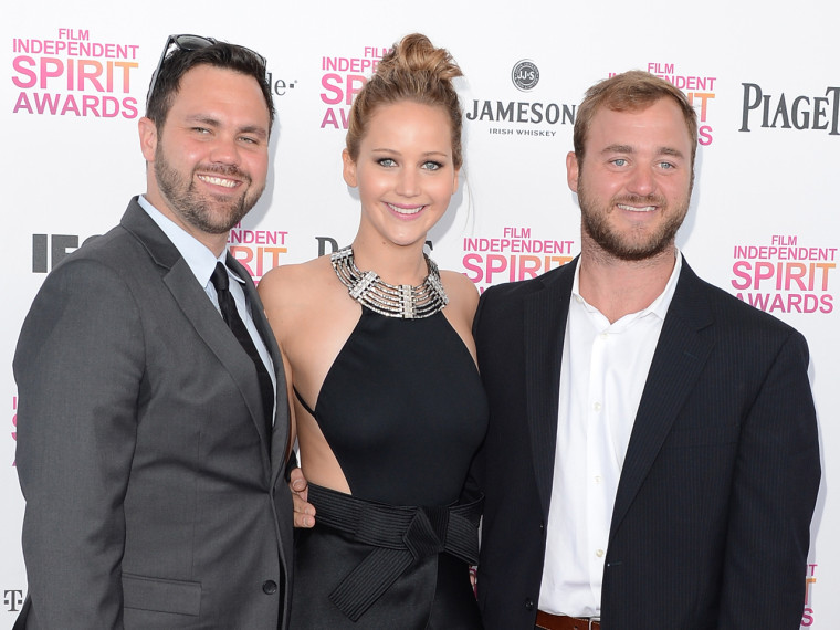 Jennifer Lawrence is flanked by brothers Ben (left) and Blaine.