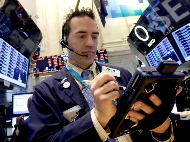 Stocks close up on upbeat economic data, central bank support