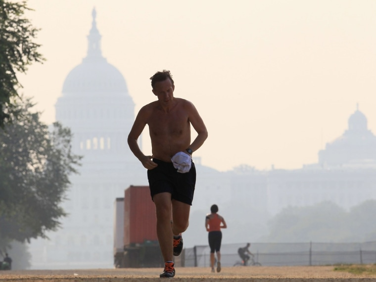 WASHINGTON, DC - JUNE 09: A jogger braves the heat as he runs along the National Mall near the U.S. Capitol, on June 9, 2011 in Washington, DC. A heat...