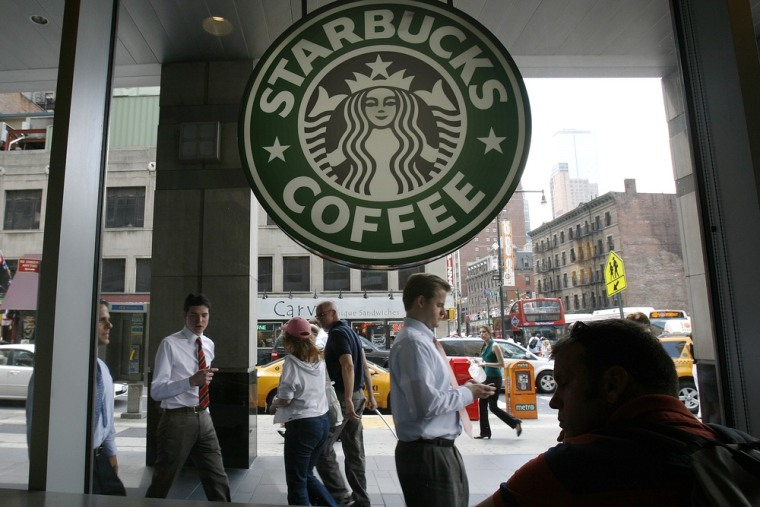 People walk past the Starbucks outlet on 47th and 8th Avenue in New York in this June 29, 2010 file photo.