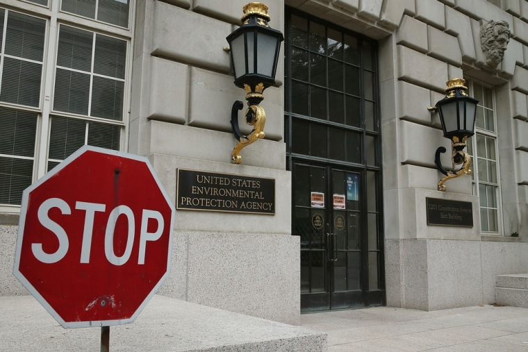 A stop sign stands outside the Environmental Protection Agency (EPA) building on May 24, 2013 in Washington, DC. Automatic spending cuts have already ...