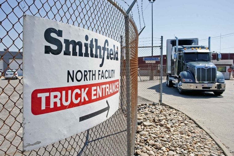 Trucks make their way around the Smithfield Foods packaging plant in Smithfield, Virginia May 30, 2013.