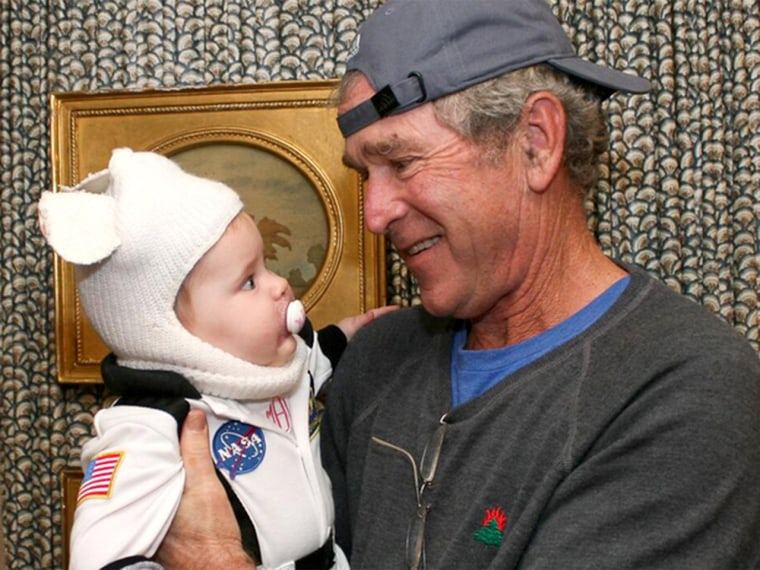 Mila dressed as an astronaut hangs out with Grandpa George W. Bush on Halloween.