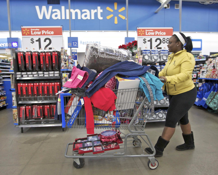 A woman with a full shopping cart heads to the checkout at a Wal-Mart Store in Chicago in this file photo taken November 23, 2012. Wal-Mart Stores In...