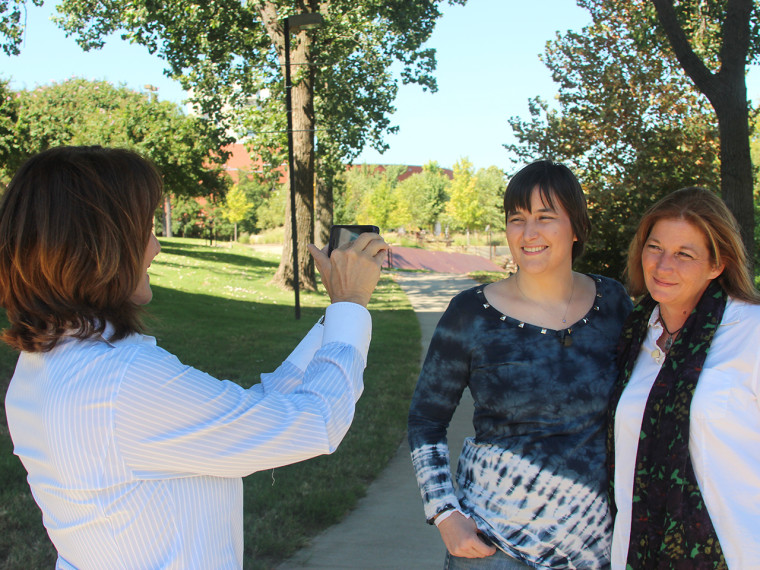 Dr. Nancy Snyderman takes a picture of her daughter, Kate, and Kate's birth mother, Cheryl Williams.