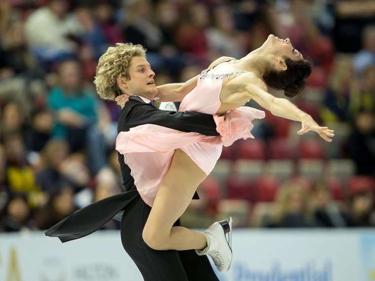 Ice dancers Meryl Davis and Charlie White of the United States skate their short dance at Skate America 2013 in Detroit, Michigan, October 18, 2013.  ...