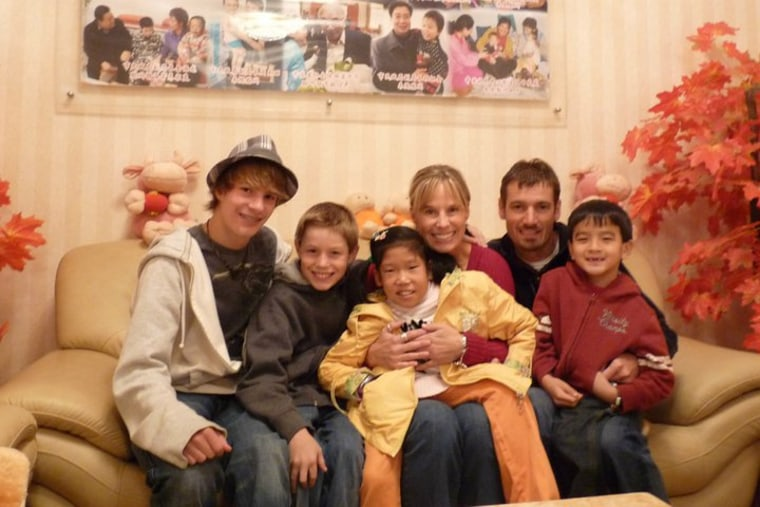 The Cunningham family on the day that daughter Cate was adopted from China.