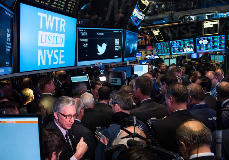 NEW YORK, NY - NOVEMBER 07: A news broadcaster reports live from the floor of the New York Stock Exchange (NYSE) during Twitter's IPO on November 7, ...