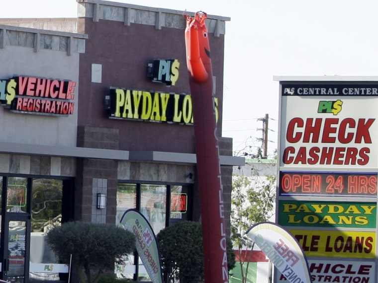 Payday loan businesses, some of them open 24-hours a day, advertise their services in Phoenix in this file photo. Consumers will have a new place to report problems with the services.