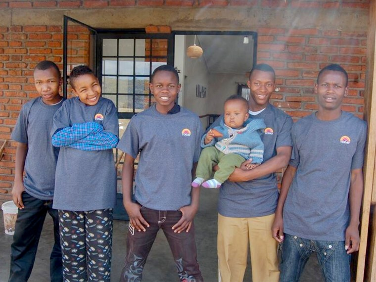Boys at the Rift Valley Children's Village show off T-shirts with the retired TODAY logo.