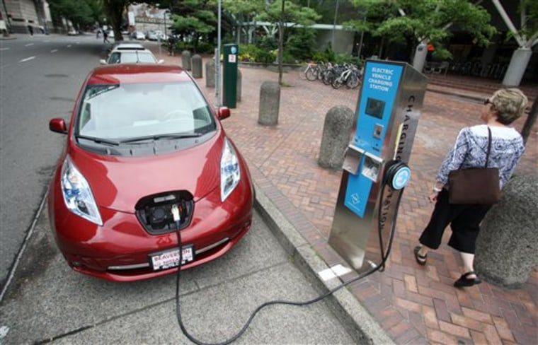 In this Aug. 18, 2011, file photo, a Nissan Leaf charges at an electric vehicle charging station in Portland, Ore. The lack of widespread infrastructure for electric vehicles is holding back their sales, says the head of Nissan/Renault.
