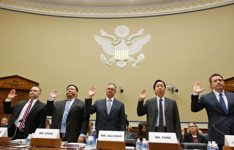 Obama Administration technology officials swear in before they testify before the House Oversight and Government Reform Committee hearing