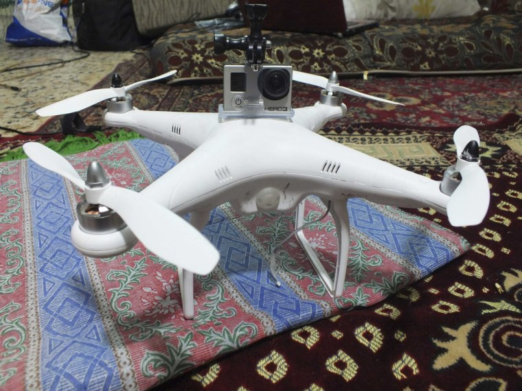 A miniature aircraft with an attached camera, which rebels say belonged to forces loyal to President Bashar al-Assad, is seen inside a room in Homs, Syria on Nov. 11, 2013.