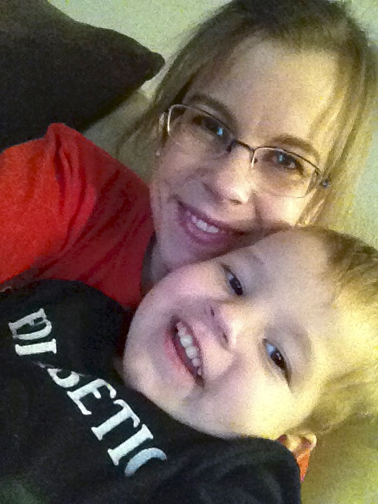 This Nov. 9, 2013 photo taken and provided by Stephanie Metz shows Metz posing for a photo with her 2-year-old son Jameson in Rapid City, S.D. Metz ha...