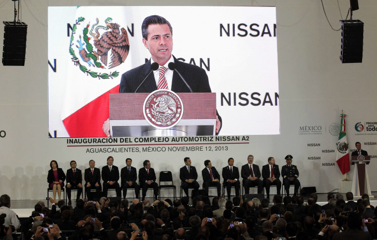 Mexico's President Enrique Pena Nieto, right, speaks during the opening of Nissan's new plant in Aguascalientes, Mexico, on Nov. 12, 2013.