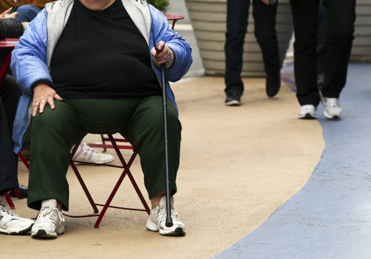 An overweight woman sits on a chair in Times Square in New York in this May 8, 2012 file photo. Obesity prevalence has increased by more than 40 perc...